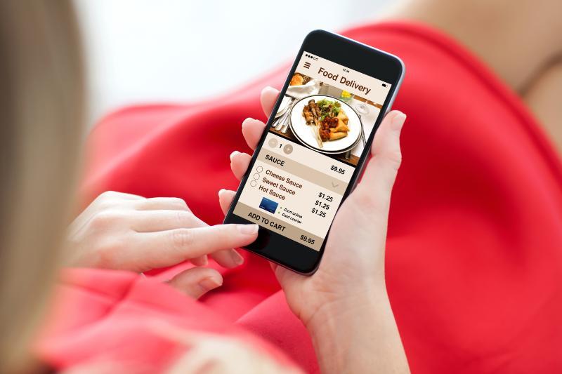 girl-orders-food-via-mobile-food-delivery-app