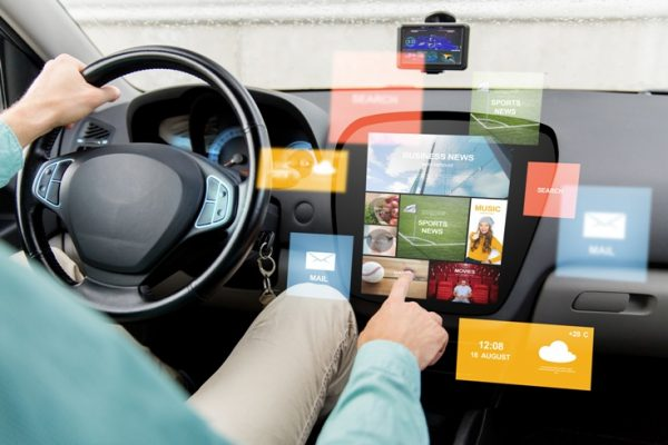 man-using-automotive-apps--in-car